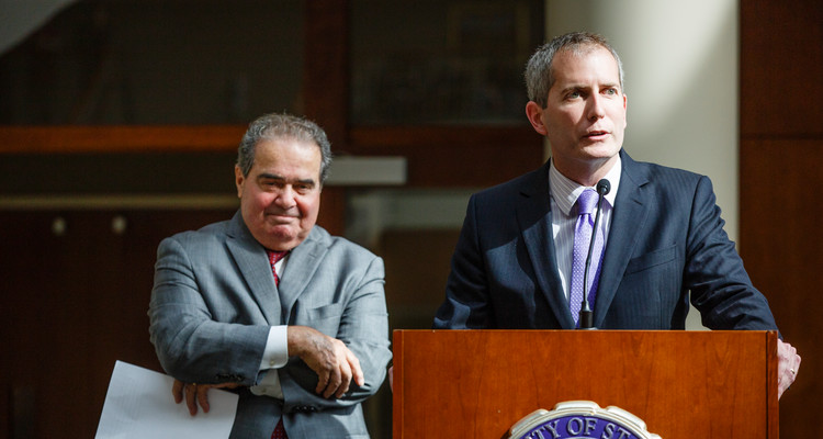 SOL Dean Robert Vischer introduces Supreme Court Justice Antonin Scalia at the Schulze Grand Atrium at the School of Law building in downtown Minneapolis on October 20, 2015.
