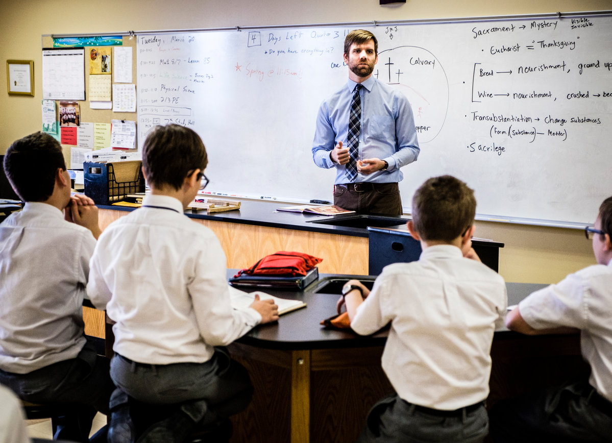 Catholic Studies alum Ben Vasko teaches his sixth grade Latin class at Ave Maria Academy March 20, 2018 in Maple Grove, MN. Taken for Lumen magazine.