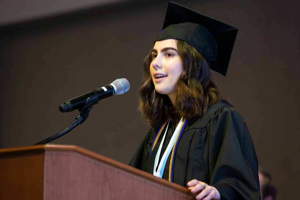 Student commencement speaker Kelly Ordonez-Saybe speaks to her classmates during commencement.