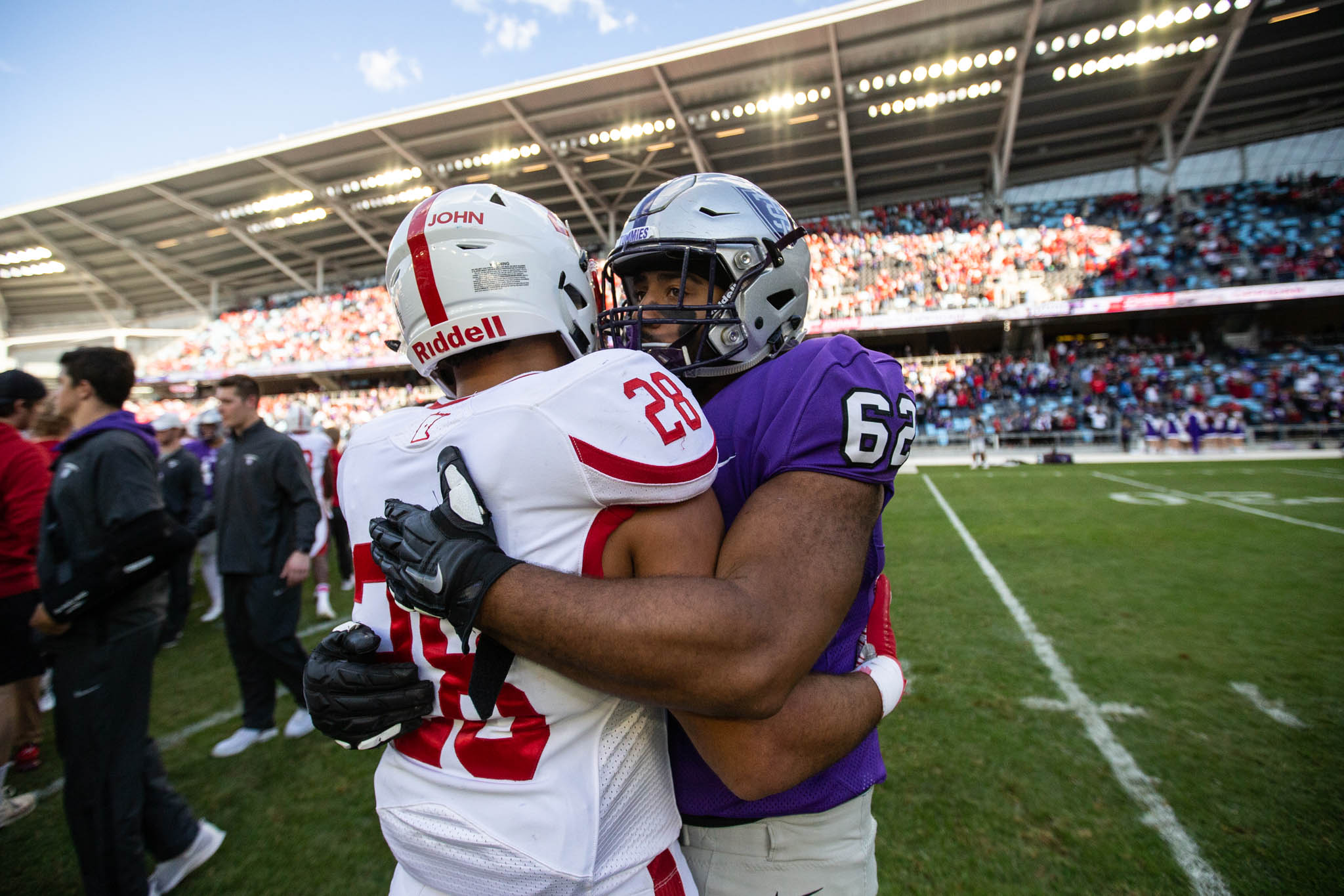 The camaraderie of the game applied to players as well as fans at the St. Thomas-St. John's football game.