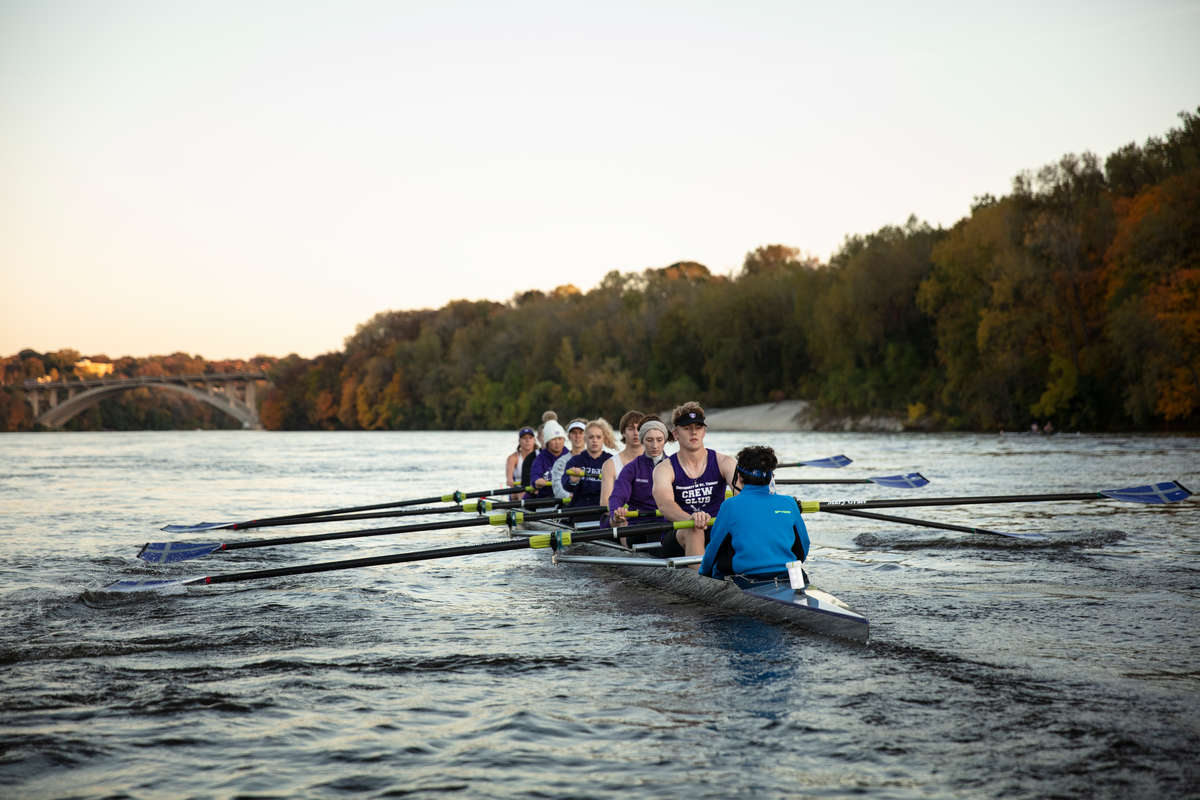 Students row during Crew Club team practice on the Mississippi River. Mark Brown/University of St. Thomas