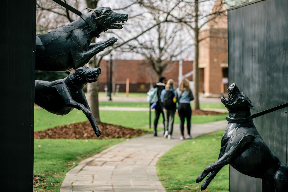 Students walk past a sculptural installation in Birmingham's Kelly Park depicting the dogs law enforcement agencies used to break up peaceful protests.