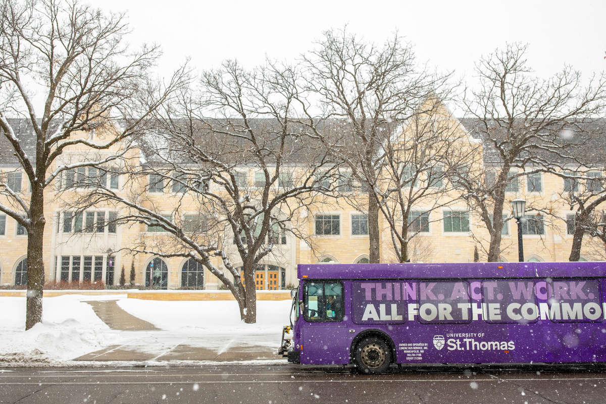 A University of St. Thomas shuttle bus on a snowy day. Mark Brown/University of St. Thomas