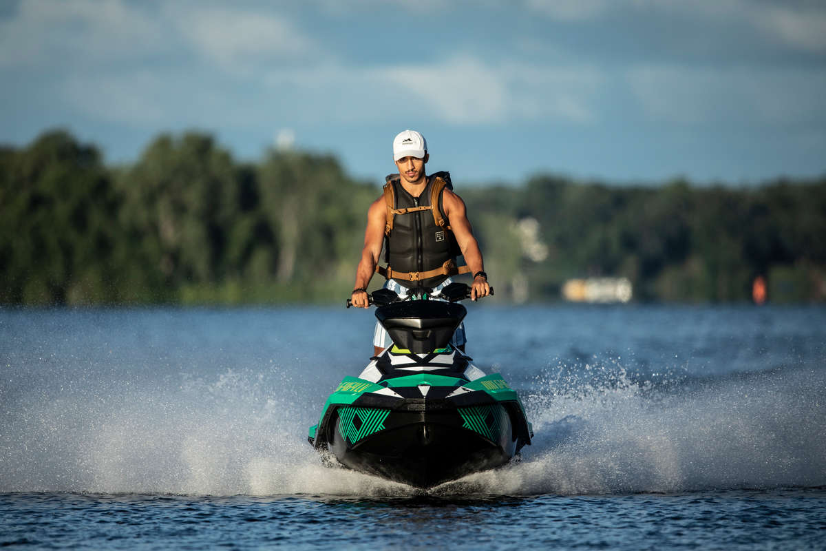 Schulze Innovation Scholar Dylan Dierking founded Foodski, a jet ski food delivery business based in White Bear Lake. Dierking takes orders for deliveries from customers ordering food from area restaurants and delivers them to homes and boats around the lake on his jet ski. Photos taken on July 22, 2020, in White Bear Lake.
