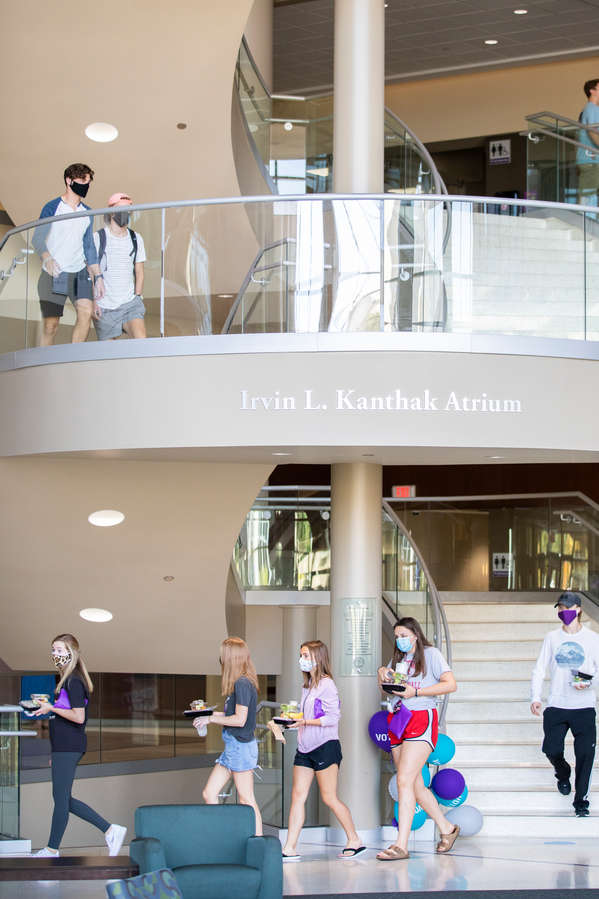 Students navigate the stairs inside the main atrium of the Anderson Student Center. Liam James Doyle/University of St. Thomas