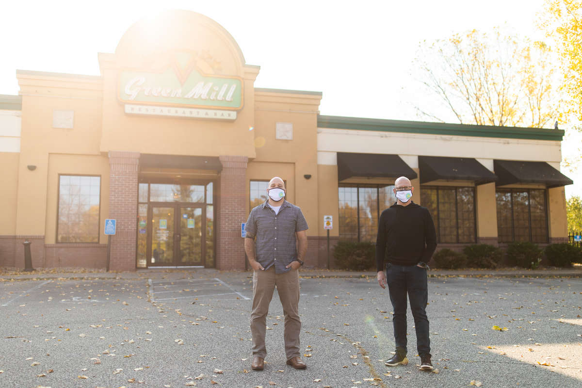 Executive MBA alumni Scott Ceplecha, left, and Matty O'Reilly pose for a portrait outside of a temporarily vacant Green Mill restaurant in Eagan on October 5, 2020. Along with their colleague, Ben Boaz, they have created a new venture, Project 53, a model in which business spaces that have emptied due to the Coronavirus pandemic can be instead used as a remote learning space for students.