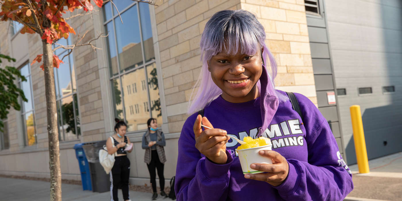 Esberance Mulonda gets a shaved ice at Kurb Side Ice Company food truck on October 9, 2020, in St. Paul. The Food Trucks were on campus as part of 2020 Homecoming celebrations.