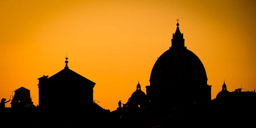 The Saint Peter's Basilica is seen in silhouette on February 28, 2013, in Rome, Italy.