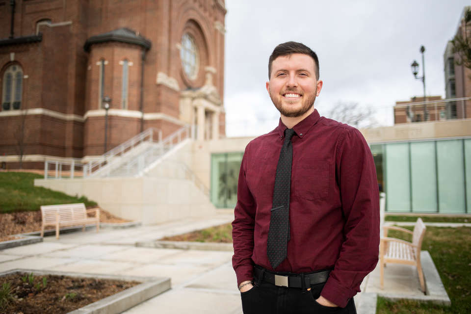Derrick Diedrich stands for a portrait outside of Aquinas Chapel and the Iversen Center for Faith in St. Paul on April 13, 2021. Derrick was photographed for a Humans of St. Thomas newsroom feature.