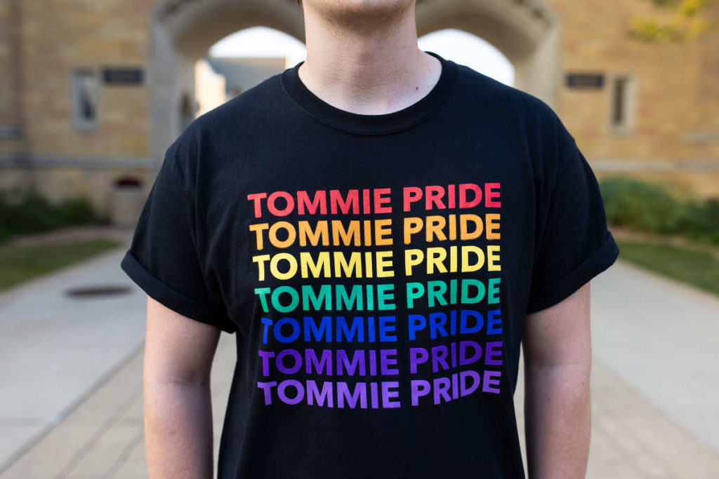 """A student models the """"Tommie Pride"""" shirt produced by Student Diversity & Inclusion Services on September 30, 2021, in St. Paul."""