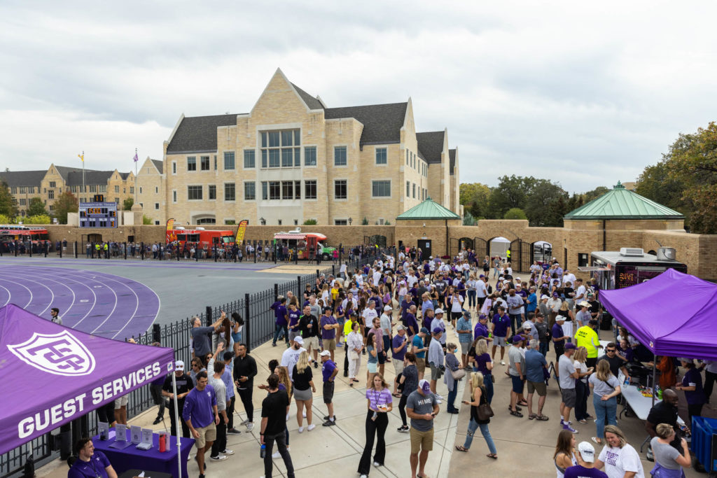 Fans gather around food trucks during the Homecoming football game. Mark Brown/University of St. Thomas